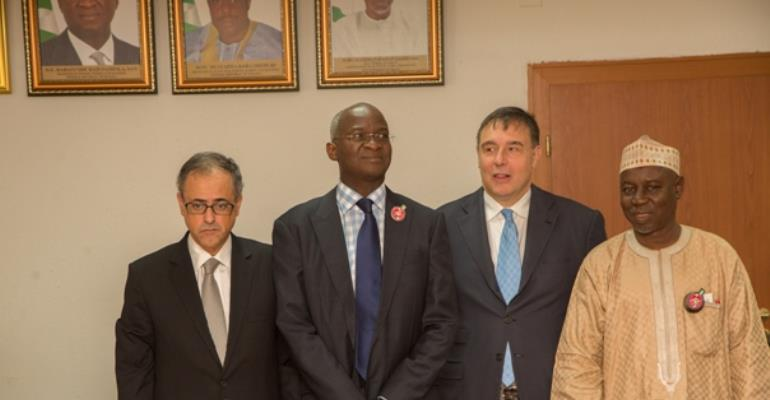 Hon. Minister of Power, Works & Housing, Mr Babatunde Fashola, SAN(2nd left), Minister of State, Surv. Suleiman Zarma Hassan(right), World Bank Senior Director,Global Energy Practice, Mr Riccardo Puliti (2nd right) and World Bank Country Director Nigeria, Mr Rachid Bermessaoud (left) in a group photograph shortly after a meeting on Nigeria's Power Sector Recovery Programme (PSRP) at the Ministry of Power, Works & Housing Headquarters, Mabushi, Abuja recently.